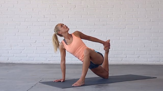 Half-Twisted Lizard (or Low Lunge Quad Stretch) opens up the hips.