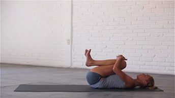 Knees-To-Chest is a restorative pose that can help to alleviate lower back pain.