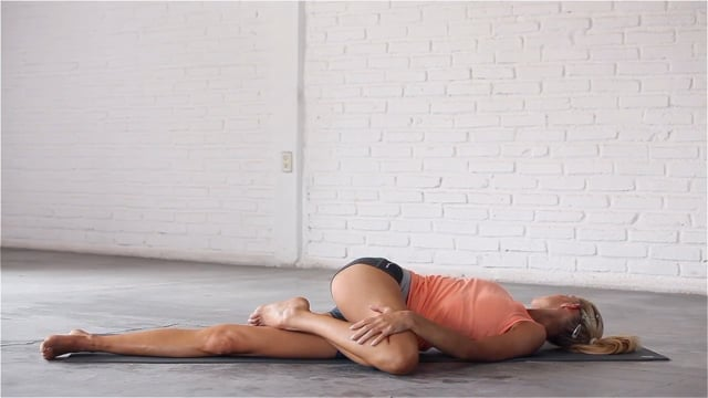 Reclining Spinal Twist alleviates lower back pain.
