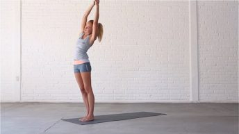 Standing Sidebend stretches the obliques and shoulders.